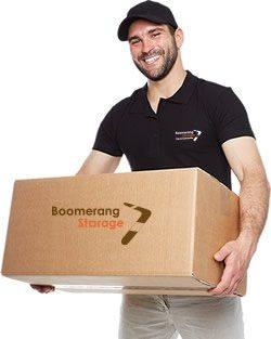 Boomerang Storage employee with box